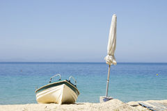 Boat and white umbrella Stock Photography