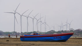 Boat and wind farm Stock Photography