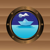 Boat window. Abstract colorful background with a boat window and a paper boat floating in the waters of the sea outside the boat Royalty Free Stock Photo