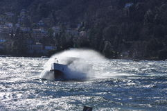 Boat on a windy lake. Splashing waves, lago Maggiore Royalty Free Stock Photos