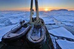 Boat in winter Arctic. White snowy mountain, blue glacier Svalba Stock Photos