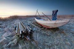 Boat in winter and a beautiful sunrise Stock Image