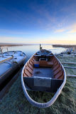 Boat in winter and a beautiful sunrise Royalty Free Stock Photography