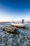 Boat in winter and a beautiful sunrise Royalty Free Stock Image