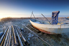 Boat in winter and a beautiful sunrise Stock Images