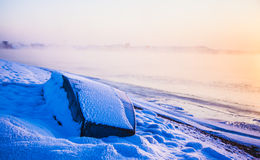 Boat in Winter sunrise. A blue boat on shore  in winter sunrise at Rime Island of China Royalty Free Stock Photos