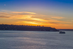 Boat on a winter sunset at Seattle waterfront Royalty Free Stock Images