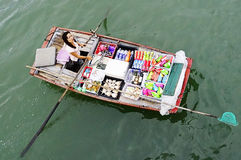Boat woman selling goods in Halong Bay Royalty Free Stock Photos