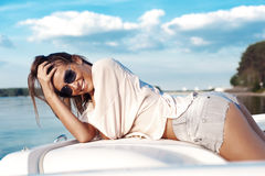 Boat woman smiling happy looking at the sea Royalty Free Stock Photos