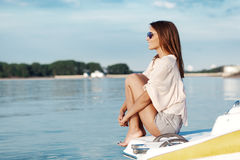 Boat woman smiling happy looking at the sea Royalty Free Stock Images