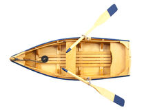 Boat of wood. Wooden boat with paddles isolated over white