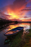 Boat and wooden bridge with  beautiful sky. Royalty Free Stock Photo