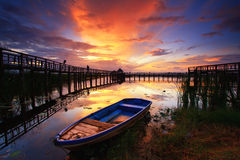 Boat and wooden bridge with beautiful sky. Royalty Free Stock Image