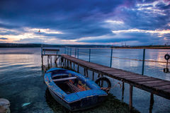 Boat at wooden pier Stock Images