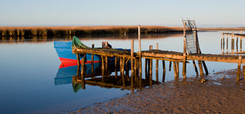 Boat on wooden pier Royalty Free Stock Photo