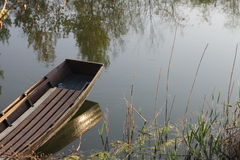 Boat. Wooden boat on the water Stock Image