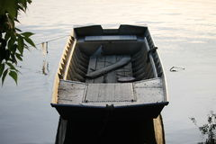 Boat. Wooden boat on the water Stock Images