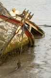 Boat wreck. Fishing boat wreck stranded in tidal mud Royalty Free Stock Photo