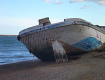 Boat wreck at a lake shore Stock Photography
