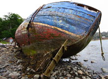 Boat wreckage. Wooden boat wreckage on a desolate beach in scotland Stock Image