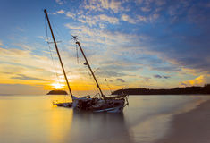 Boat and Yacht abandoned with a beautiful sunset in the east of. The country Royalty Free Stock Photos