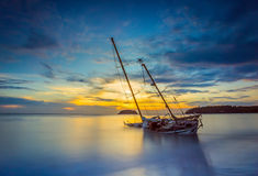 Boat and Yacht abandoned with a beautiful sunset in the east of. The country Royalty Free Stock Photo