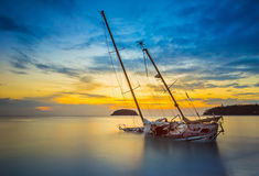 Boat and Yacht abandoned with a beautiful sunset in the east of. The country Stock Photos