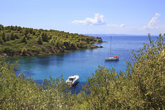 Boat and yacht in a bay of Aegean Sea. Royalty Free Stock Photography