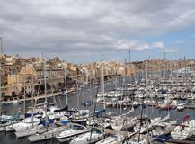 Boat and Yacht Marina in Vitriossa, Malta. Busy marina in Malta, near Valletta. Full of yachts and sailing boats with historic architecture of Vitriossa in the stock image