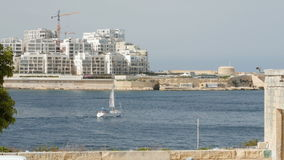 Boat -Yacht sails in the background of Valletta in Malta stock video footage