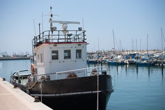 Boat in yachting community in Mediterranean sea Stock Photos