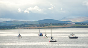 Boat and yachts moored on the Cromarty Firth. Royalty Free Stock Photography
