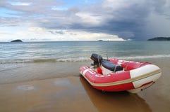Boat at Yalong Bay. Boat on the beach with view out toward water at Yalong Bay in Sanya, China Stock Photography
