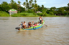 On the boat from yangon full boat. Boat full of people on the rive from yangon Stock Image