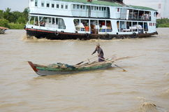 On the boat from yangon man canoes along. Boat full of people on the rive from yangon Royalty Free Stock Photo