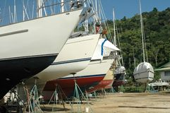 Boat Yard Caribbean. Sailboats on the hard in boatyard in the Caribbean of Trinidad Royalty Free Stock Images