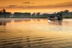 Boat on Yellow Water billabong at dawn, Northern Territories, Australia stock photography