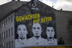Boateng. DECEMBER 2013 - BERLIN: a painted portrait of soccer stars and brothers Jerome Boateng, George Boateng and Kevin Prince Boateng on the wall of an Stock Images