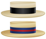 Boater hat. Traditional boater hats with variations in straw and ribbon color Royalty Free Stock Image