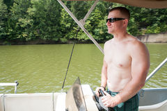 Boater: Man Piloting Motorboat royalty free stock image