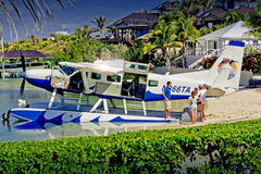 Boater photographing Sea Plane at Abaco Inn, Elbo Cay Abaco, Bahamas. Beached Sea Plane at Abaco Inn on Elbo Cay, Abaco, Bahamas stock images