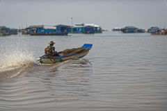Boater in river at Tonle Sap, Cambodia. Man boating river in fishing village of Tonle Sap, Cambodia Stock Photos