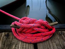 Boater's Rope. Pink boater's cord on dock stock photography