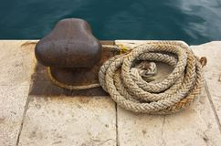 Boater's rope on dock Royalty Free Stock Photos