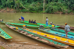 Boaters carry passengers on a small river. Laos, Luang Prabang Royalty Free Stock Photos