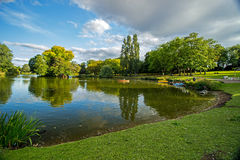 Boaters on small lake at park, Birmingham, England Royalty Free Stock Photos