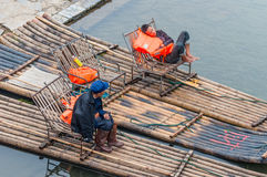 Boaters on their bamboo raft on the bank of the Li River Royalty Free Stock Photo