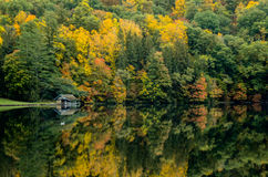Boathouse Along Lake in Fall Stock Photo