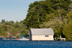 Boathouse with Canadian flag Stock Images