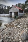 Boathouse on frozen Loch Vaa in the Cairngorms National Park of Scotland. Boathouse on frozen Loch Vaa near Aviemore in the Cairngorms National Park of Scotland Royalty Free Stock Image